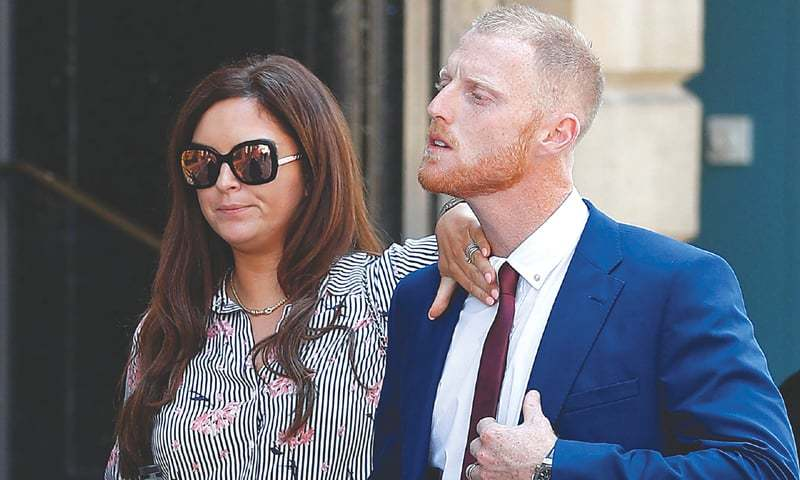 BRISTOL Clare Stokes, wife of England cricketer Ben Stokes sorts out her husband's collar as they return to Bristol Crown Court after a lunch break on Monday.—AFP