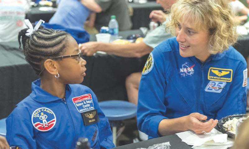 NASA astronaut Dottie Metcalf (right) talks to space-camp camper Bria Jackson of Atlanta before giving a speech at the US Space & Rocket Center in Huntsville, Alabama.—AP