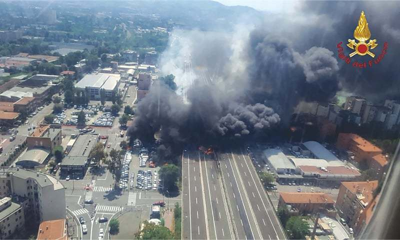 Bologna: Black smoke shoots into the sky after the tanker exploded.—AFP