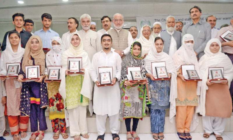 Position holders of HSSC exam results with Provincial Education Minister Prof Dr Sara Safdar in Peshawar on Monday. — White Star