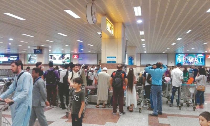 Lahore: Pakistanis stranded in China pictured at Allama Iqbal International Airport upon their return aboard Shaheen Air International flight NL-891 on Monday.—White Star