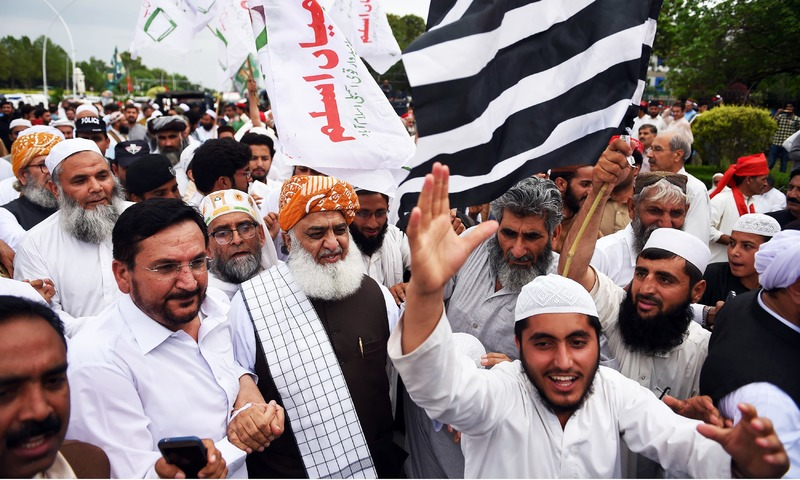 MMA chief Fazlur Rehman arrives to a protest outside the election commission office against the alleged election rigging. —AFP