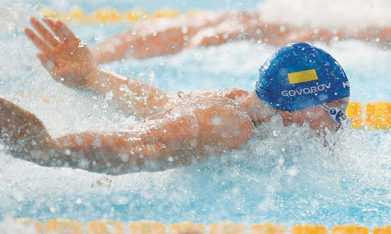 GLASGOW: Ukraine's Andriy Govorov competes on his way to winning gold in the men's 50m butterfly final in the European Championships at the Tollcross Swimming Centre.—AFP