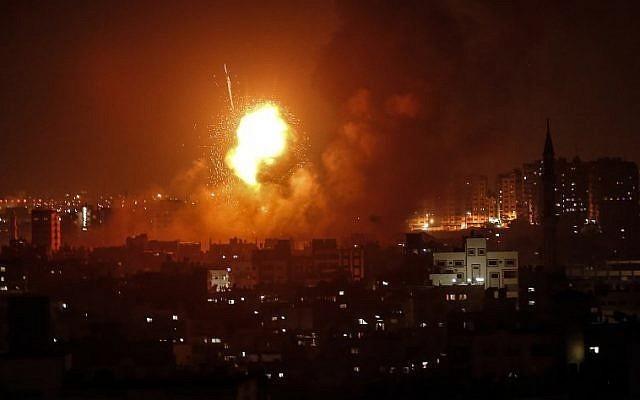 An explosion rocks Gaza following an Israeli air strike on August 8. — AFP