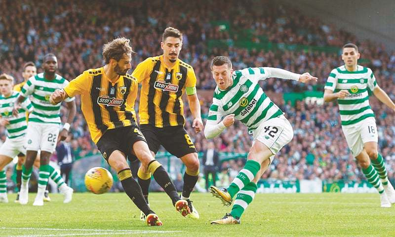 GLASGOW: Celtic's Callum McGregor (second R) scores against AEK Athens during the UEFA Champions League third qualifying round first leg at Celtic Park.—Reuters