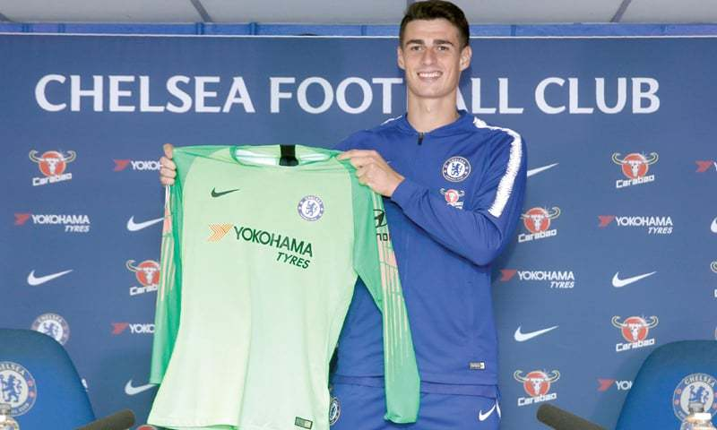 LONDON: Chelsea's Kepa Arrizabalaga holds up the team's shirt during his unveiling press conference at Stamford Bridge.—AFP