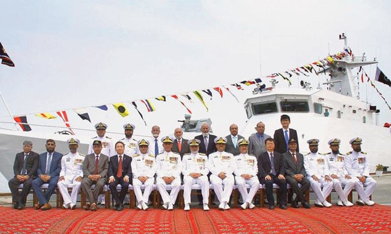 Vice Admiral Abdul Aleem in a group photo with the project team of the Karachi Shipyard & Engineering Works and the China Shipbuilding & Trading Company at the commissioning of  PMSS Zhob.—APP