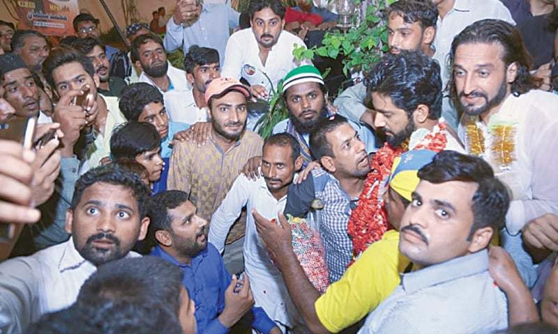 Salman Naeem's supporters celebrate his win from PP-217 against Shah Mehmood Qureshi on election night.—Dawn file photo