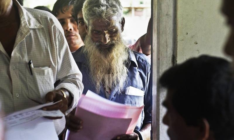 People whose names did not appear in the National Register of Citizens (NRC) draft stand in a queue to collect forms to file appeals in Mayong, 45 kilometers (28 miles) east of Gauhati, India on Friday. — AP