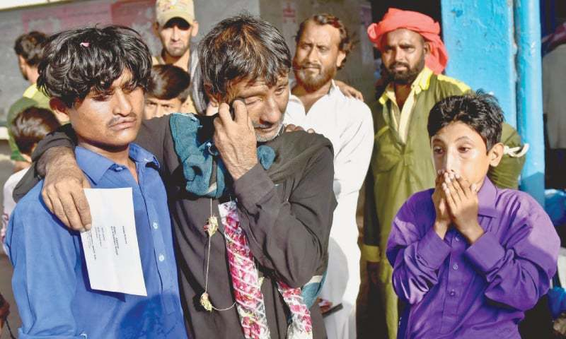 One of the 14 Pakistani fishermen who reached Karachi from Lahore by the Shalimar Night Coach Express on Friday cannot hold back the tears of joy, and relief, on being reunited with his family after two-and-a-half years of separation. —White Star