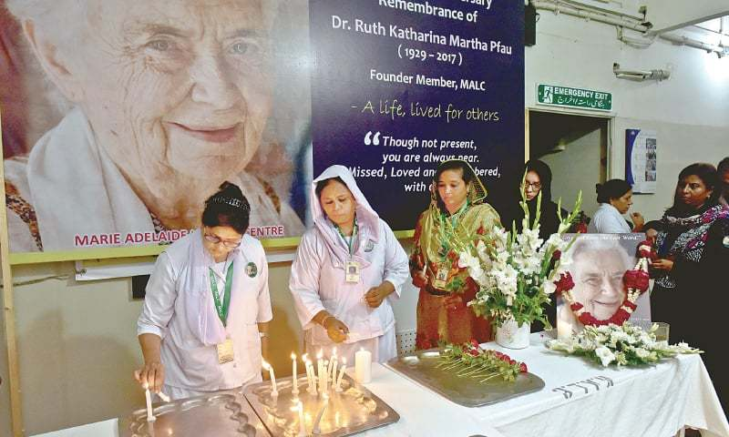 The Marie Adelaide Leprosy Centre staff observe Dr Ruth Pfau's first death anniversary with flowers and a candlelit vigil here on Friday. —Fahim Siddiqi / White Star
