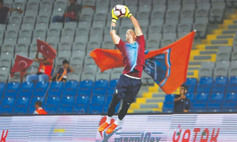 ISTANBUL: Burnley's Joe Hart warms up before the first leg of their Europa League third qualifying round tie against Istanbul Basaksehir at the Fatih Terim Stadium.—Reuters