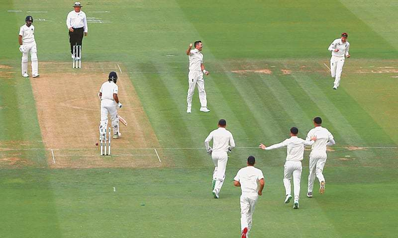LONDON: England pace bowler James Anderson celebrates after taking the wicket of Indian opener Murali Vijay at Lord's on Friday.—Reuters