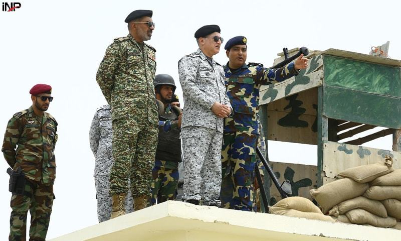CHIEF of the Naval Staff Admiral Zafar Mahmood Abbasi being briefed on naval operations at the forward post of Shumal Bandar.—INP