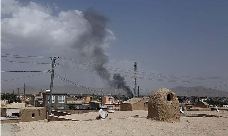 Smoke rising into the air after Taliban militants launched an attack on the Afghan provincial capital of Ghazni on August 10. — AFP