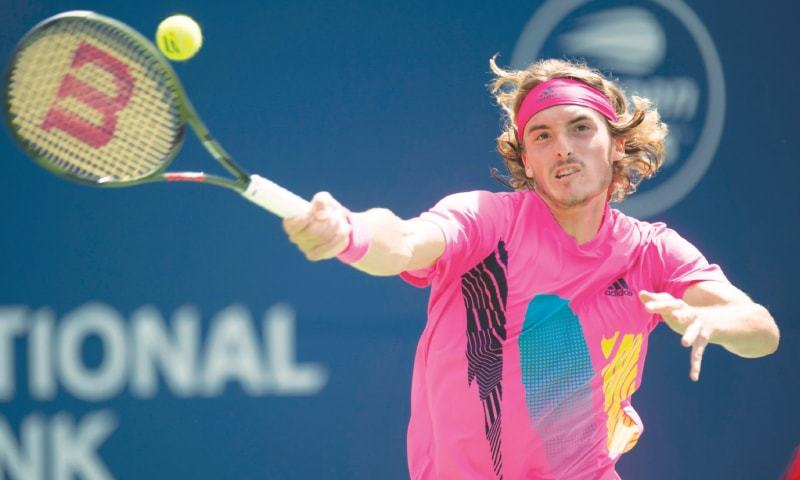 TORONTO: Stefanos Tsitsipas hits a forehand to Alexander Zverev during their Rogers Cup quarter-final on Friday.—AP