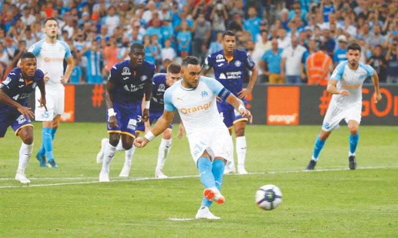MARSEILLE: Olympique de Marseille's Dimitri Payet shoots to score from the penalty spot against Toulouse during the Ligue 1 match at the Orange Velodrome.—Reuters