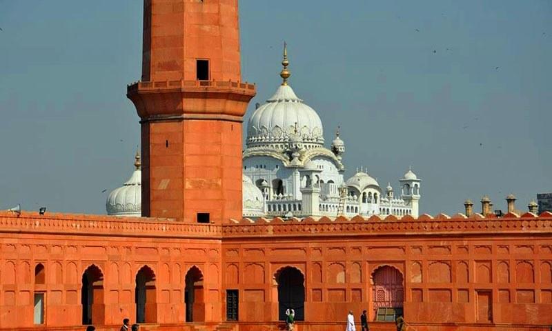 Badshahi Mosque with the Gurdwara Dera Sahib in the background.—Jahanzeb Hussain