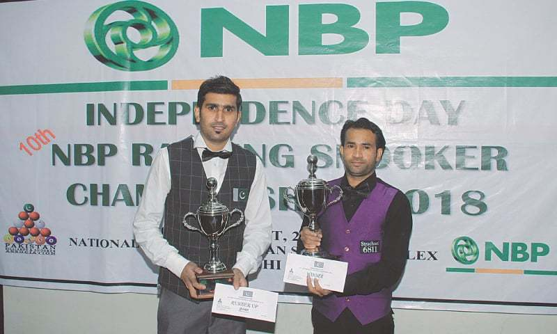 KARACHI: Mohammad Ijaz (R) and Babar Masih pose for a photograph  after the final of the 10th NBP ranking snooker championship on Monday.