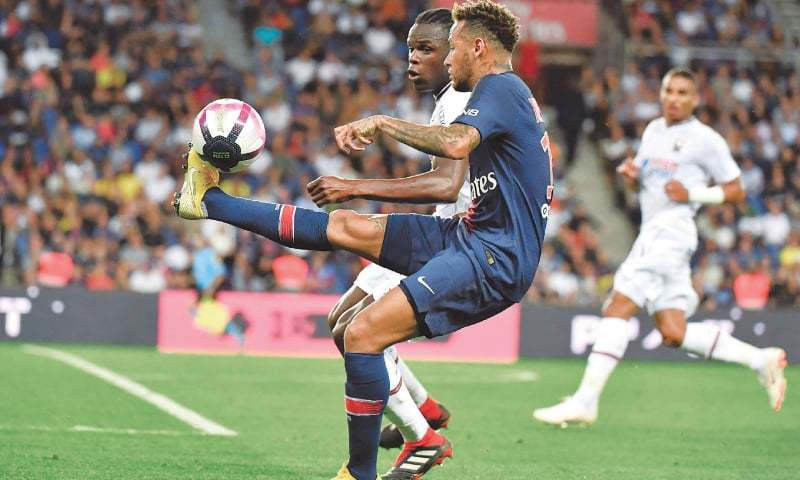PARIS: Paris St Germain's Neymar controls the ball during the Ligue 1 match against Caen at the Parc des Princes.—AFP
