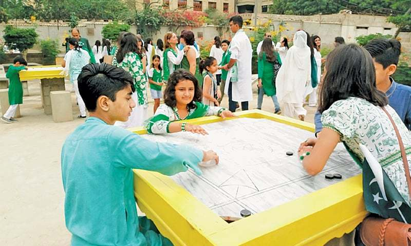 CHILDREN play carom at the newly inaugurated Lignum Park on Tuesday.—Photo by writer