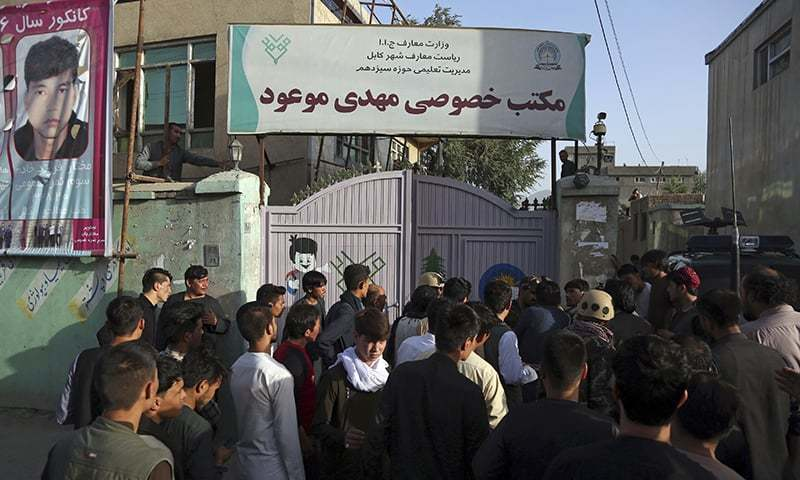 People gather at the site of a deadly suicide bombing that targeted a training class in a private building in the Shia neighbourhood of Dasht-i Barcha, in western Kabul. —AP