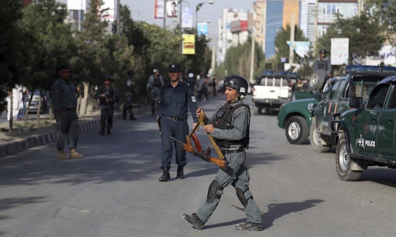Security personnel arrive at the site of the deadly suicide bombing. —AP