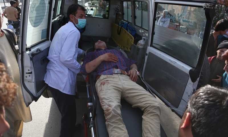 A man who was injured in the suicide bombing is placed in an ambulance. —AP
