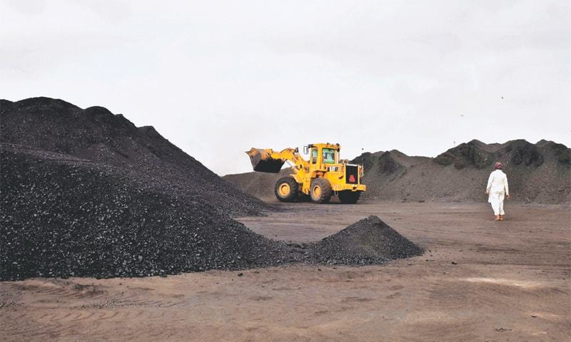 COAL is being unloaded from a truck in Juma Goth, Landhi.—Fahim Siddiqi/White Star