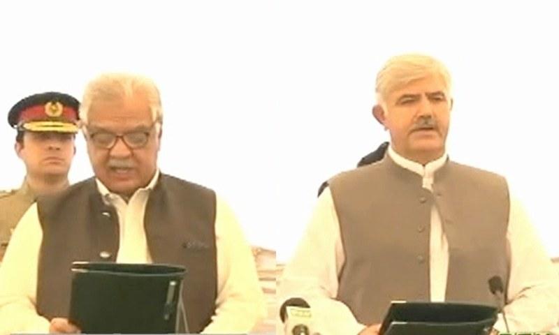 Mahmood Khan (L) swears oath as KP's 22nd CM. — DawnNews TV