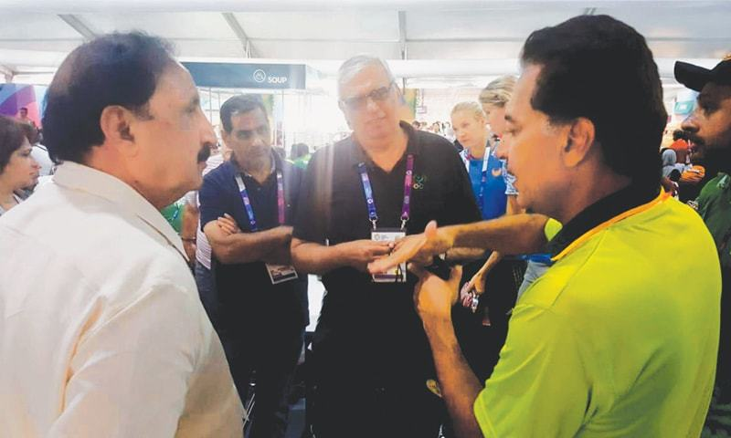 JAKARTA: POA president retired Lt Gen Syed Arif Hasan (C) listens to national hockey team manager Hasan Sardar (R) during his visit to the athletes villages at the 18th Asian Games on Friday.