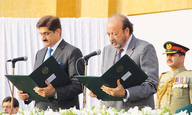 ACTING Governor Agha Siraj Durrani administers oath to Murad Ali Shah on Saturday.—Online