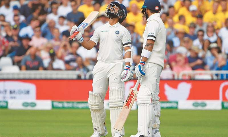 NOTTINGHAM: Indian batsman Ajinkya Rahane (L) celebrates reaching his half-century as captain Virat Kohli looks on during the third Test at Trent Bridge on Saturday.—AFP