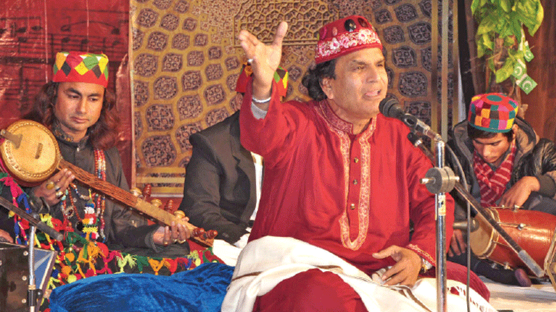 Qurban Niazi sings Sufi verses during a musical evening in Rawalpindi, 2014.