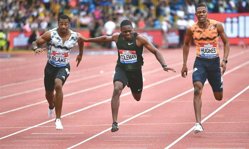 BIRMINGHAM: US' Christian Coleman (C) dips for the line to win the men's 100m final ahead of Jamaica's Yohan Blake in fourth (L) and Great Britain's Zharnel Hughes in fifth during the IAAF Birmingham Diamond League meeting at Alexander Stadium.—AFP