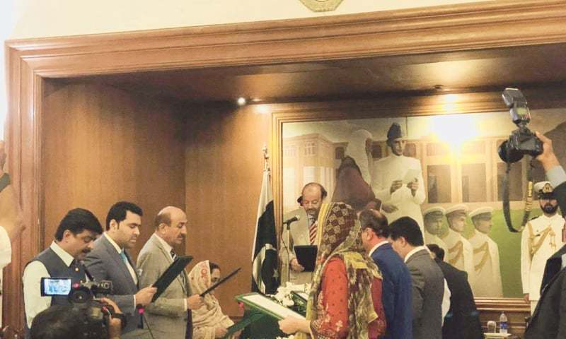 MEMBERS of the new Sindh cabinet take oath at Governor House on Sunday.