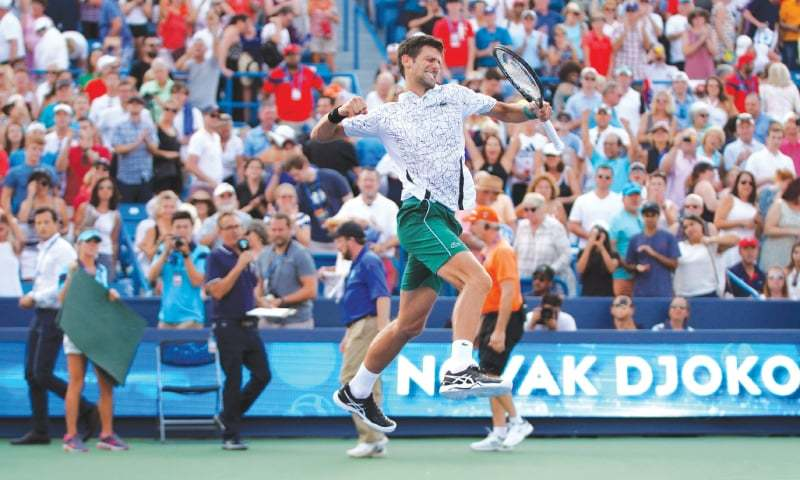 CINCINNATI: Serbia's Novak Djokovic jumps in joy after winning the final of the Western and Southern Open against Roger Federer of Switzerland at the Lindner Family Tennis Center.—Reuters