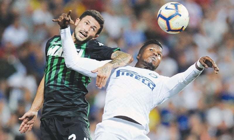 REGGIO EMILIA: Sassuolo's Stefano Sensi (L) challenges Inter Milan's Keita Balde during their Serie A match at the Mapei Stadium.—Reuters