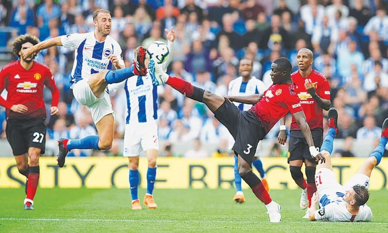 BRIGHTON: Brighton & Hove Albion's Glenn Murray (second L) vies for the ball with Manchester United's Eric Bailly during their Premier League match at the American Express Community Stadium.—Reuters