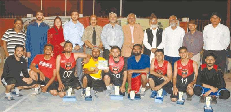 KARACHI: Members of victorious Karachi Basketball Club outfit pose with chief guest Col Mazhar Shah and KBBA officials at Arambagh courts.