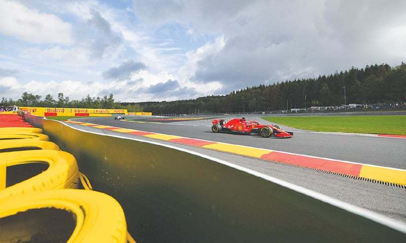 SPA-FRANCORCHAMPS: Ferrari's Sebastian Vettel of Germany drives during the first practice session for the Belgian F1 Grand Prix on Friday.—AFP