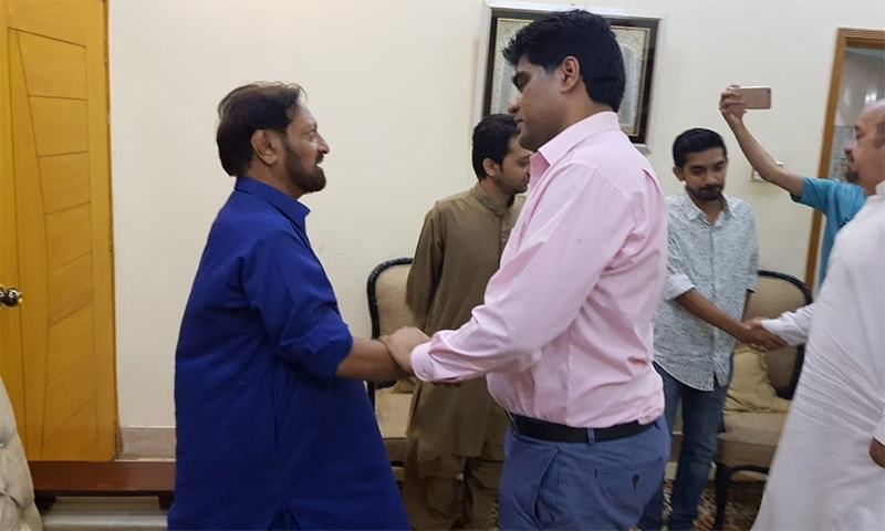 MPA Imran Shah (right) pictured tendering an apology to citizen Dawood Chauhan (left).