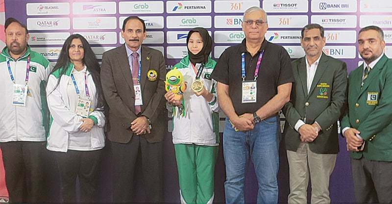 PAKISTAN'S bronze medal winner Nargis (C) is seen with POA president retired Lt Gen Arif Hasan, secretary Khalid Mahmood and chairman Pakistan Karate Federation Mohammad Jahangir on Saturday.