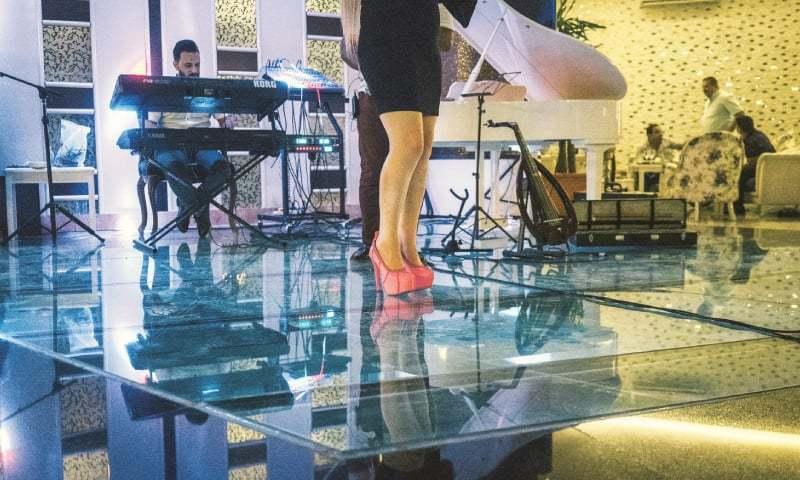 A singer performs at the Ibraheem Basha bar. —The Washington Post