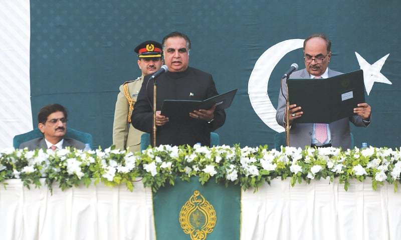 IMRAN Ismail is administered his gubernatorial oath by SHC Chief Justice Ahmed Ali M. Shaikh at Governor House on Monday.—White Star