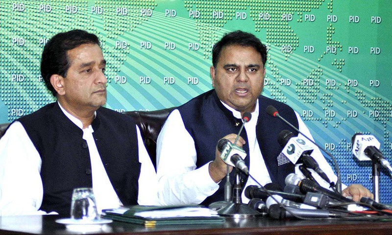 Federal Minister for Information and Broadcasting Fawad Ahmed Chaudhry along with Adviser to PM on Climate Change Amin Aslam address a press conference. — APP