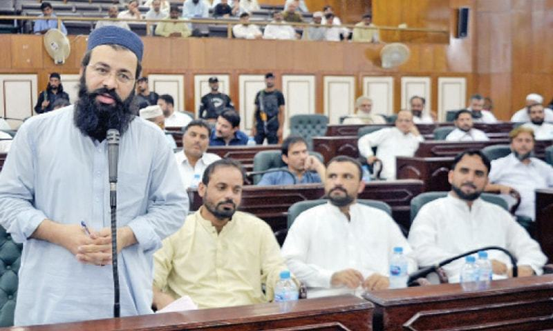District nazim Mohammad Asim addresses the Peshawar district council session on Wednesday. — White Star