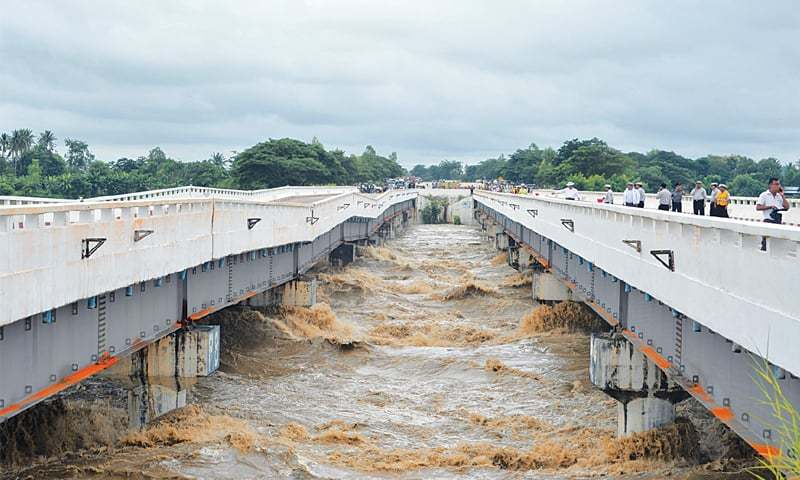 A major bridge along Yangon to Mandalay highway linking Yangon to capital Naypyidaw is seen damaged by rampaging flood waters from a dam on Wednesday.—AFP