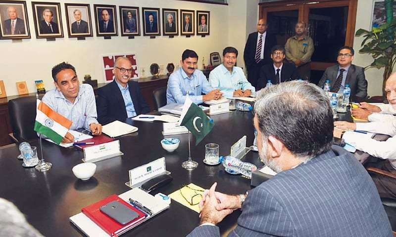 Lahore: Pakistan's Commissioner for Indus Waters Syed Mohammad Mehr Ali Shah and his Indian counterpart Pradeep Kumar Saxena hold talks on Wednesday.—M. Arif / White Star