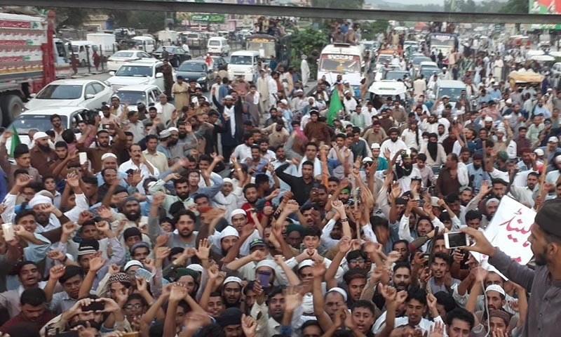 TLP supporters shout slogans during their march towards Islamabad. — Javed Hussain